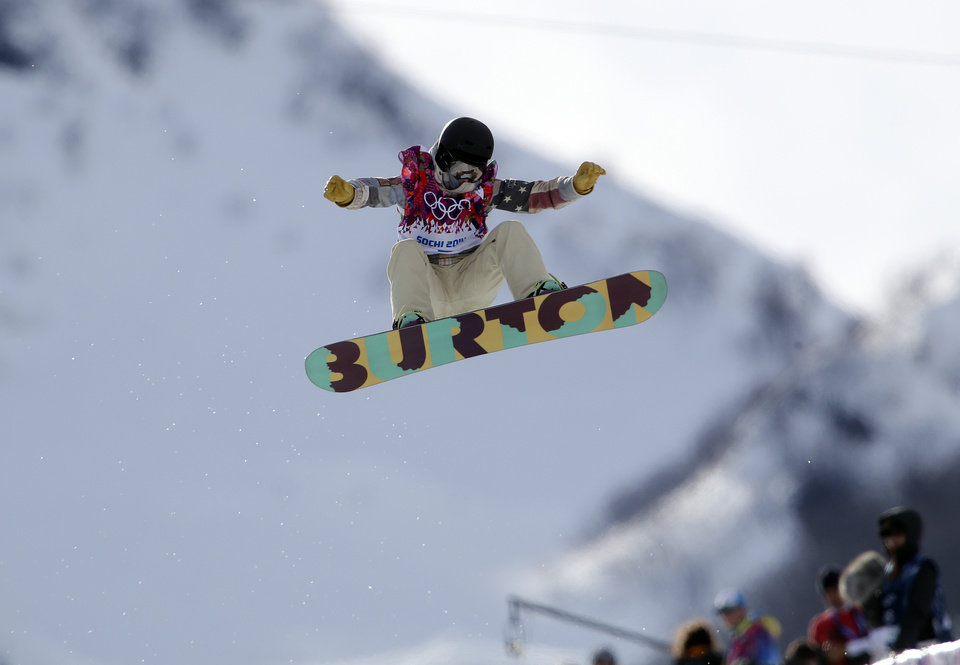Photo - United States' Kelly Clark competes in the women's snowboard half pipe qualifying at the Rosa Khutor Extreme Park, at the 2014 Winter Olympics, Wednesday, Feb. 12, 2014, in Krasnaya Polyana, Russia. (AP Photo/Sergei Grits)