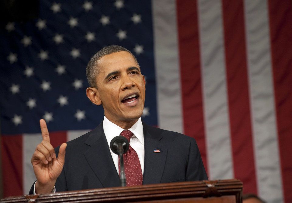 Photo - President Barack Obama delivers his State of the Union address on Capitol Hill in Washington, Tuesday, Jan. 24, 2012. (AP Photo/Saul Loeb, Pool) ORG XMIT: WX161