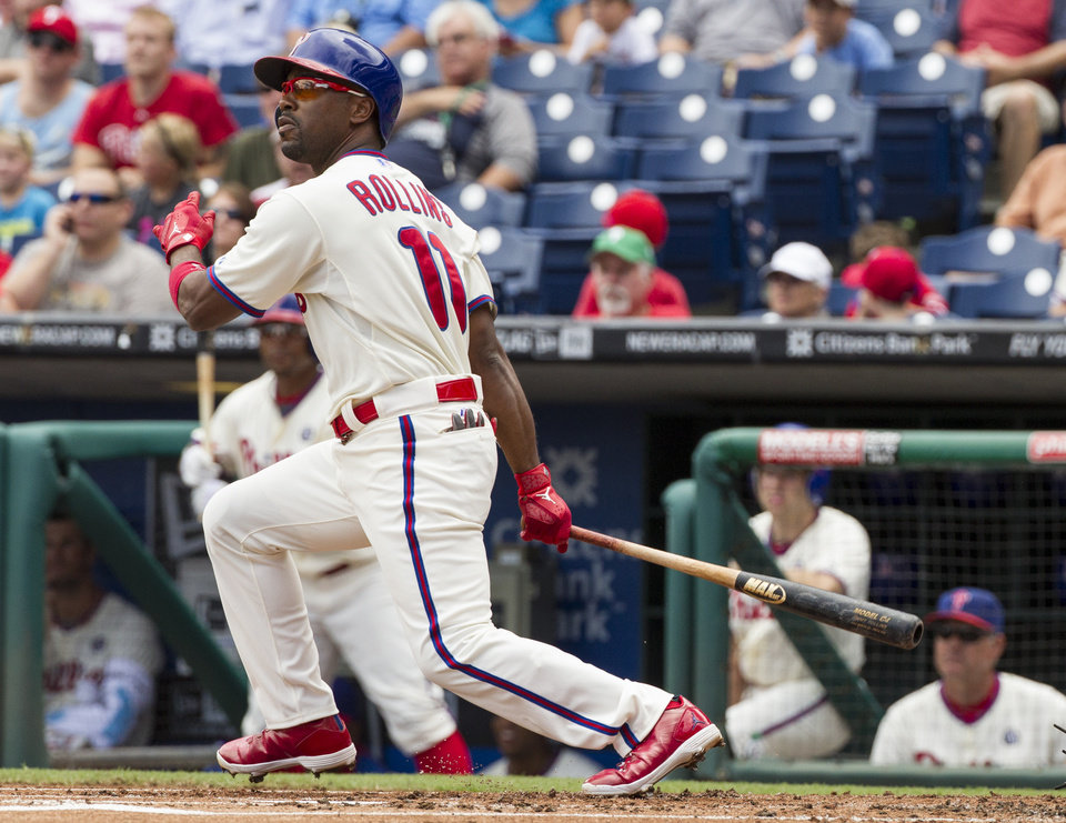 Photo - Philadelphia Phillies' Jimmy Rollins hits a double during the first inning of a baseball game against the San Francisco Giants, Thursday, July 24, 2014, in Philadelphia. (AP Photo/Chris Szagola)