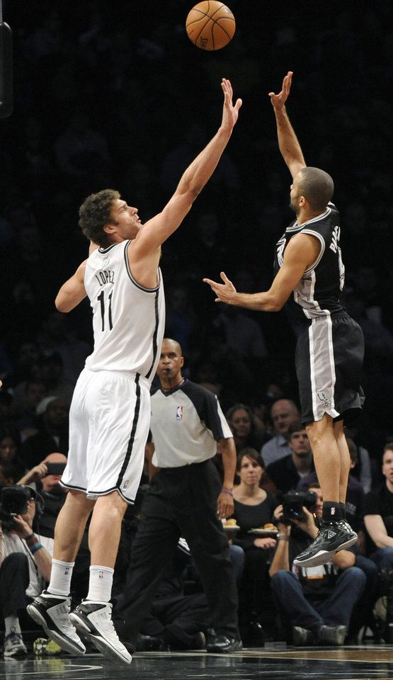 San Antonio Spurs' Tony Parker (9) shoots over Brooklyn Nets' Brook Lopez (11) in the first half of an NBA basketball game, Sunday, Feb. 10, 2013, at Barclays Center in New York. (AP Photo/Kathy Kmonicek)
