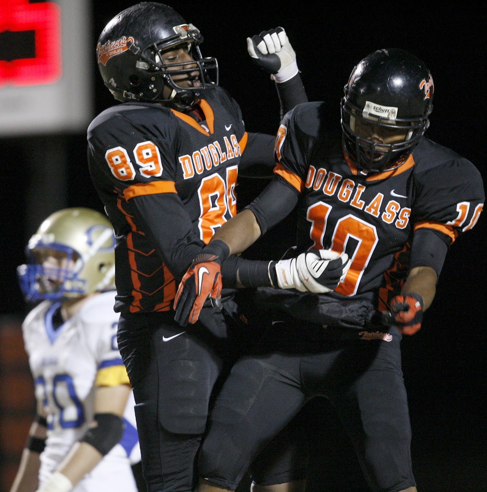 Douglass' Donnell Ward, right, and Deondre Clark celebrate after a touchdown during a high school football playoff game against Oologah in Oklahoma City, Friday, Nov. 19, 2010.  Photo by Bryan Terry, The Oklahoman