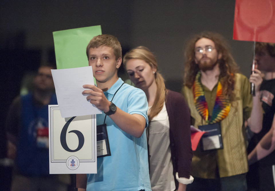 Photo - Young Adult Advisor Scott Overacker, of Roanoke, VA., front, adds his voice to the debate on whether the church should recognize same-sex marriage at the  221st General Assembly of the Presbyterian Church at Cobo Hall, in Detroit, Thursday, June 19, 2014. The top legislative body of the Presbyterian Church (U.S.A.) voted by large margins to recognize same-sex marriage as Christian in the church constitution, adding language that marriage can be the union of