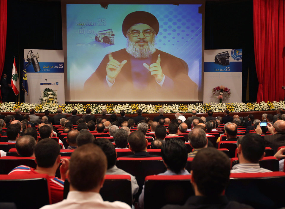 Photo - Hezbollah leader Sheik Hassan Nasrallah speaks via video during a conference, held in a southern suburb of Beirut, Lebanon, Thursday May, 9, 2013. Nasrallah said Syria will supply `game-changing' weapons to the Lebanese militant group. (AP Photo/Hussein Malla)