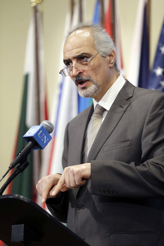 Photo - Syrian Ambassador to the United Nations Bashar Ja'afari speaks to reporters after a meeting about Syria at United Nations headquarters Wednesday, Aug. 28, 2013. The five permanent members of the U.N. Security Council met informally to discuss the language of a draft resolution that would authorize the use of military force against Syria. (AP Photo/Seth Wenig)