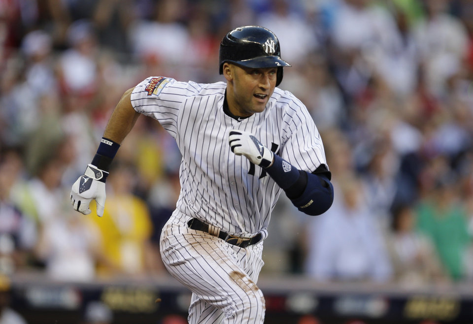 Photo - Shortstop Derek Jeter, of the New York Yankees, doubles during the first inning of the MLB All-Star baseball game, Tuesday, July 15, 2014, in Minneapolis.  (AP Photo/Jeff Roberson)