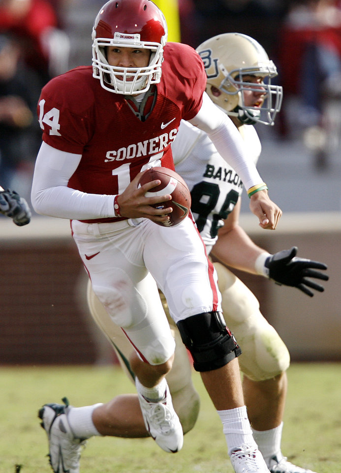 Photo - Oklahoma's Sam Bradford (14) takes the ball up field on a run play during the second half of the college football game between the University of Oklahoma Sooners (OU) and the Baylor University Bears at Gaylord Family -- Oklahoma Memorial Stadium on Saturday, Oct. 10, 2009, in Norman, Okla.    Photo by Chris Landsberger, The Oklahoman. ORG XMIT: KOD