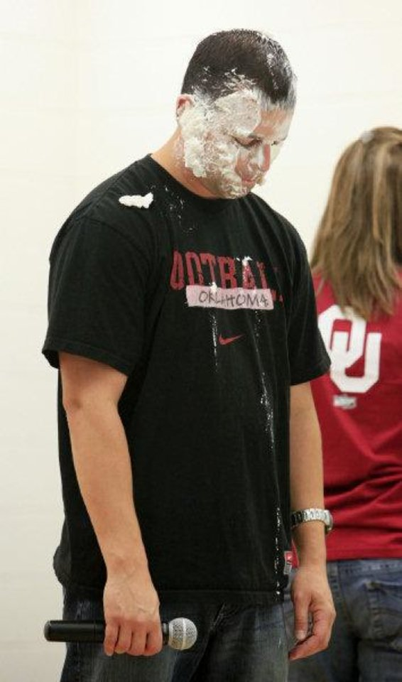 Heritage Trails Elementary School Principal Jason Perez reacts after getting a pie in the face courtesy of Jason White during an assembly Wednesday at the school. PHOTO BY PAUL SOUTHERLAND, THE OKLAHOMAN <strong>PAUL B. SOUTHERLAND - PAUL B. SOUTHERLAND</strong>