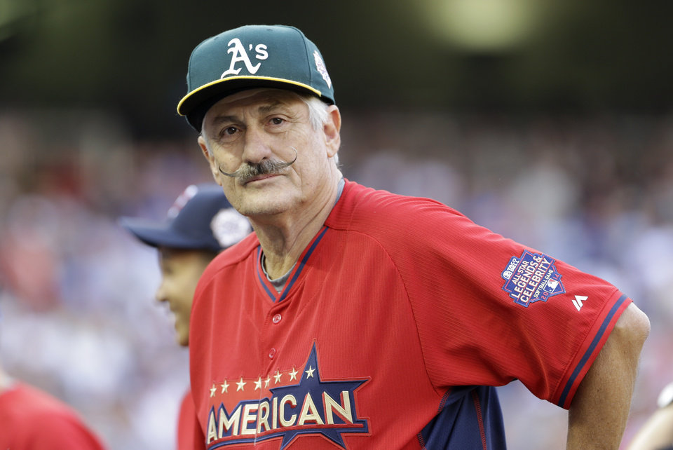 Photo - Former major league pitch pitcher Rollie Fingers looks on during the All-Star Legends & Celebrity Softball Game, Sunday, July 13, 2014, in Minneapolis. (AP Photo/Paul Sancya)