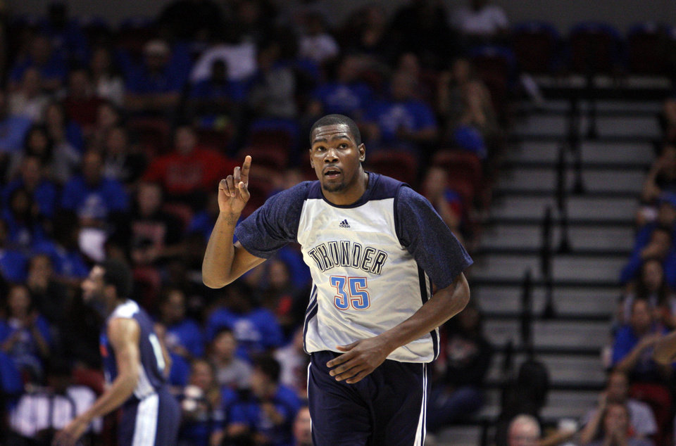 Photo - OKC Thunder player Kevin Durant point up after making a 3-pointer during the Blue-White scrimmage at the SpiritBank Event Center, on Thursday, Oct. 18, 2012. CORY YOUNG/Tulsa World