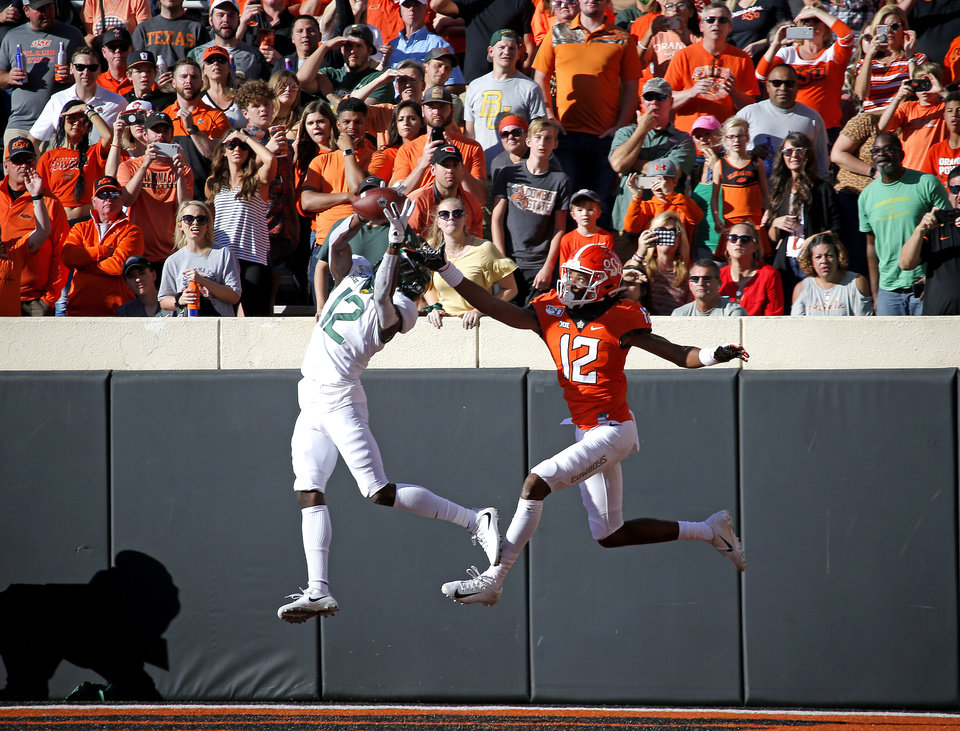 Photo - Baylor's Kalon Barnes (12) intercepts a pass intended for Oklahoma State's Jordan McCray (12) in the second quarter during the college football game between Oklahoma State University and Baylor at Boone Pickens Stadium in Stillwater, Okla., Saturday, Oct. 19, 2019. [Sarah Phipps/The Oklahoman]