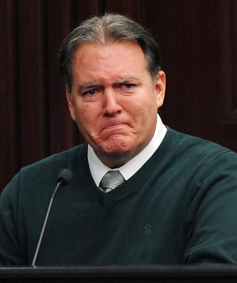 Photo - Michael Dunn, takes the stand in his own defense during his trial in Jacksonville, Fla., Tuesday, Feb. 11, 2014. Dunn is charged with fatally shooting 17-year-old Jordan Davis after an argument over loud music outside a Jacksonville, Fla. convenient story in 2012.(The Florida Times-Union, Bob Mack, Pool)