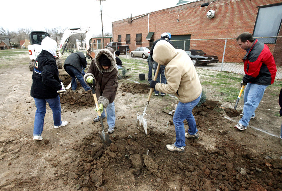 "Volunteers with ""Friends of Edgemere Elementary"" endure bitter temperatures as they plant 40 trees on the grounds of Edgemere Elementary School in Oklahoma City, OK, Saturday, Feb. 11, 2012. By Paul Hellstern, The Oklahoman"