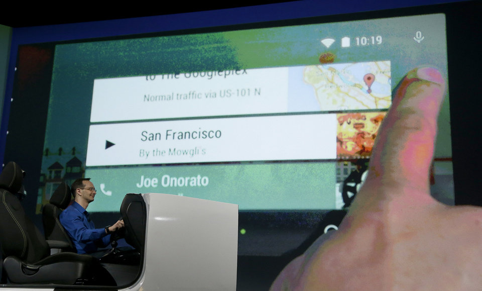 Photo - A demonstration of Android Auto is given during the Google I/O 2014 keynote presentation in San Francisco, Wednesday, June 25, 2014. As the Internet giant's Android operating system stretches into cars, homes and smartwatches, this year's annual confab will expand on its usual focus on smartphones and tablets. (AP Photo/Jeff Chiu)