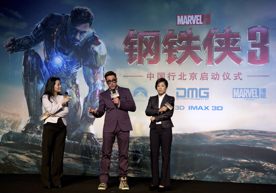 Photo - U.S. actor Robert Downey Jr, center, speaks on stage during the world premiere event of his new movie