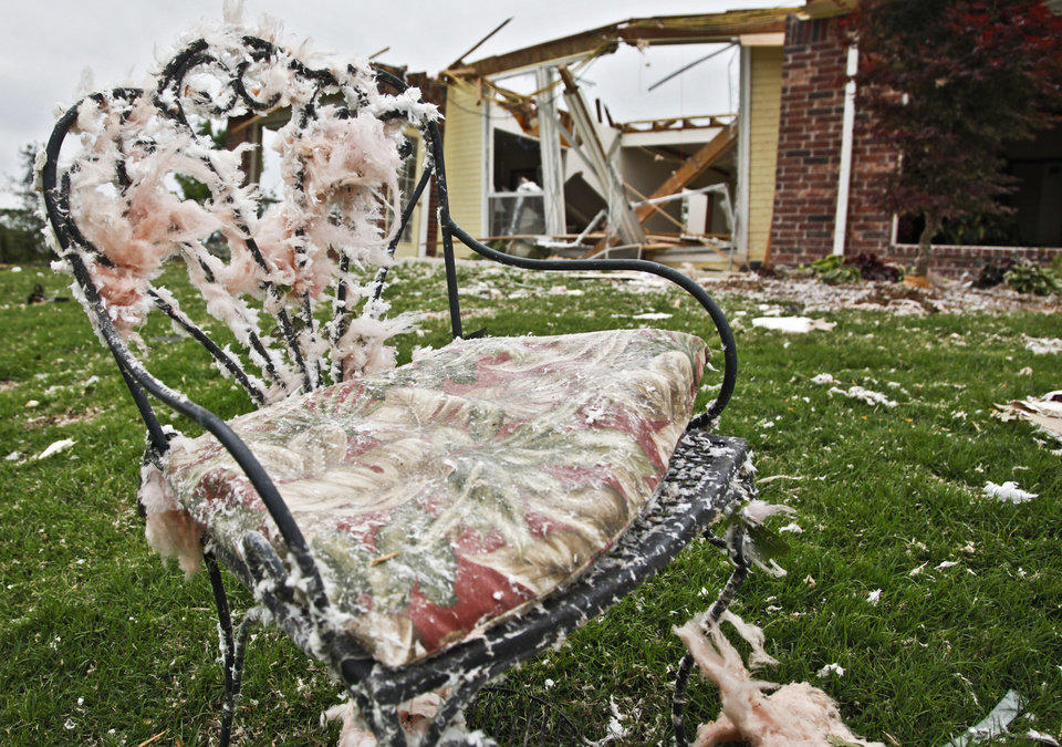 A lawn chair sits covered in insulation in the debris on Monday, May 10, 2010, in Oklahoma City, Okla. left behind by the tornados that hit central oklahoma on Monday. Photo by Chris Landsberger, The Oklahoman