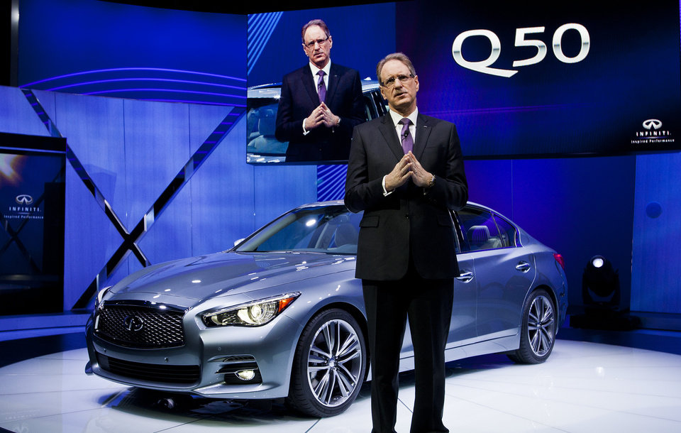 Photo - Infiniti President Johan de Nysschen talks about the Infiniti Q50 at the North American International Auto Show, Monday, Jan. 14, 2013, in Detroit, Mich. (AP Photo/Tony Ding)