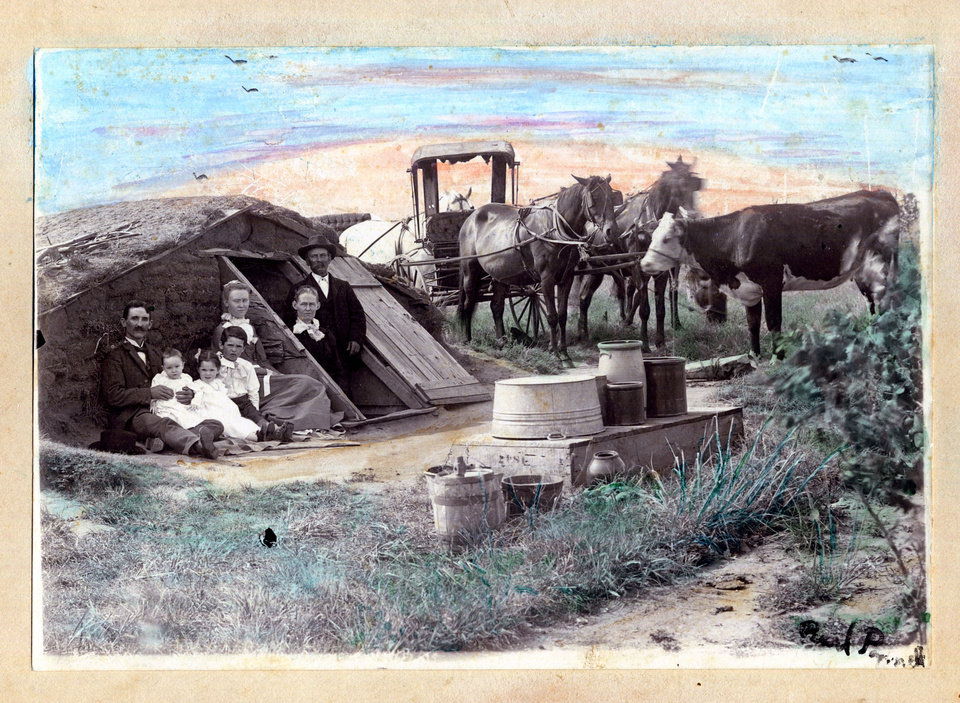 Photo - A family is shown at a dugout, a home carved into the prairie, in this early Oklahoma Territory photo.   - PROVIDED BY OKLAHOMA HISTORICAL