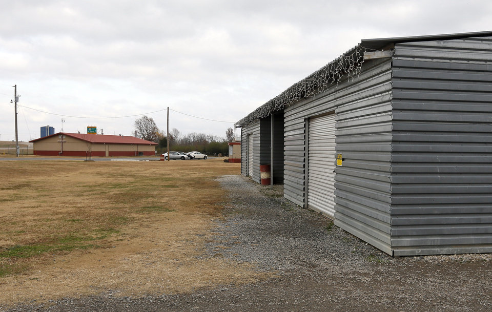 Photo -  The grounds around Ray's House drug recovery program facility in Muskogee include the storage building on the right and Choices Church in the distance. [Photo by Nate Billings, The Oklahoman]