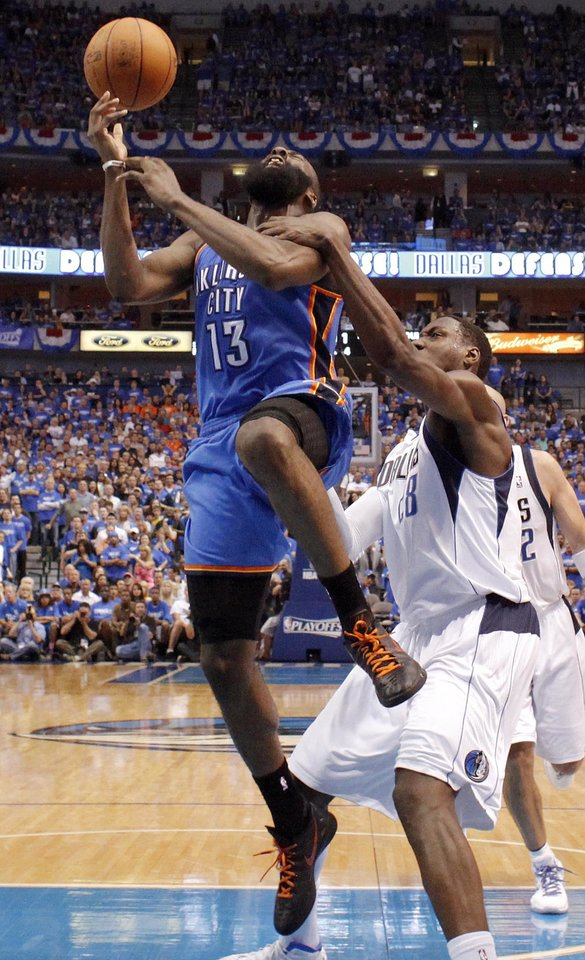 Photo - Oklahoma City's James Harden (13) is fouled by Dallas' Ian Mahinmi (28) during Game 4 of the first round in the NBA playoffs between the Oklahoma City Thunder and the Dallas Mavericks at American Airlines Center in Dallas, Saturday, May 5, 2012. Photo by Bryan Terry, The Oklahoman