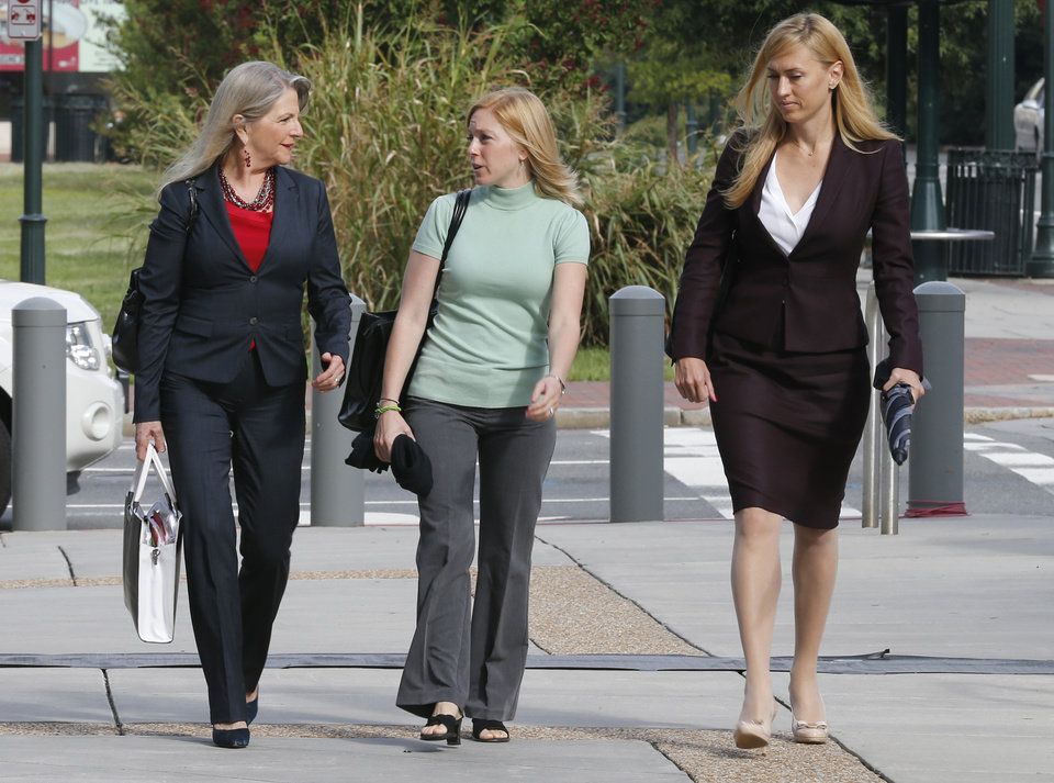 Photo - Former Virginia first lady, Maureen McDonnell, left, talks with her Daughter Cailin Young, center, and her attorney Heather Martin, as they arrive at federal court in Richmond, Va., Tuesday, Aug. 19, 2014. The McDonnells are presenting the second day of his defense on corruption charges. (AP Photo/Steve Helber)
