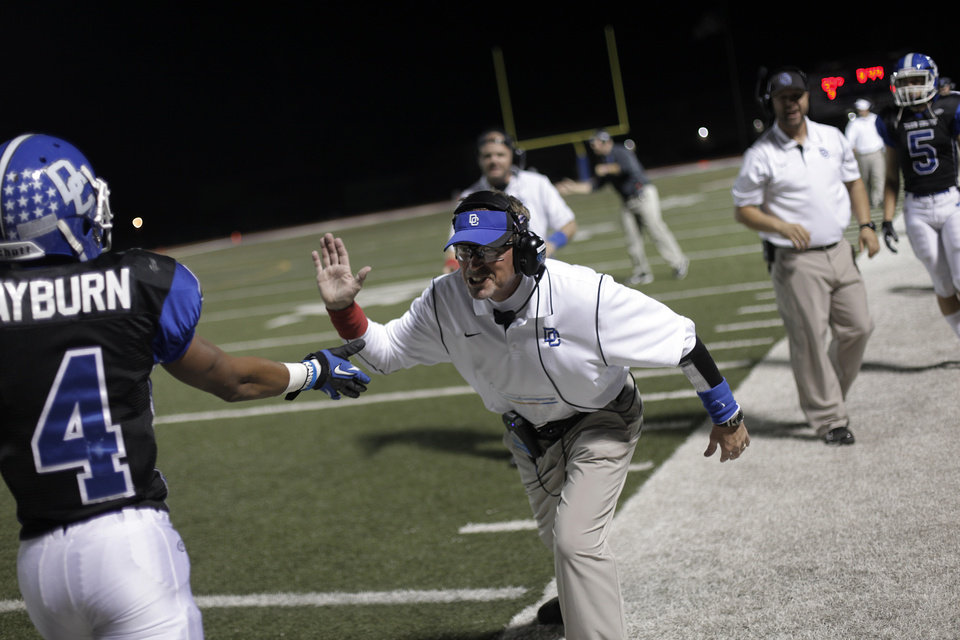 Photo - Deer Creek head coach Grant Gower celebrates with Jared Rayburn (4) after a touchdown during a high school football game between Deer Creek and Ardmore at Deer Creek Stadium in Edmond, Okla., Friday, Nov. 9, 2012.  Photo by Garett Fisbeck, The Oklahoman