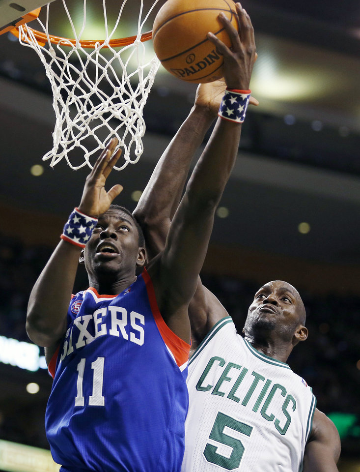 Philadelphia 76ers' Jrue Holiday (11) shoots in front of Boston Celtics' Kevin Garnett (5) during the third quarter of an NBA basketball game in Boston, Friday, Nov. 9, 2012. The 76ers won 106-100. (AP Photo/Michael Dwyer)