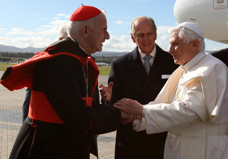Photo - FILE - This is a Thursday, Sept,16, 2010 file photo Pope Benedict XVI, right,  is greeted by  Cardinal Keith O'Brien  in Edinburgh, Scotland, to begin the first papal state visit to the UK    Cardinal O'Brien resigned Monday Feb 25, 2013 due to allegations of misconduct. (AP Photo/Andrew Milligan, Pool)