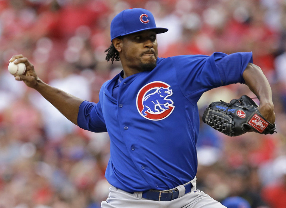 Photo - Chicago Cubs starting pitcher Edwin Jackson throws against the Cincinnati Reds in the first inning of a baseball game, Monday, July 7, 2014, in Cincinnati. (AP Photo/Al Behrman)