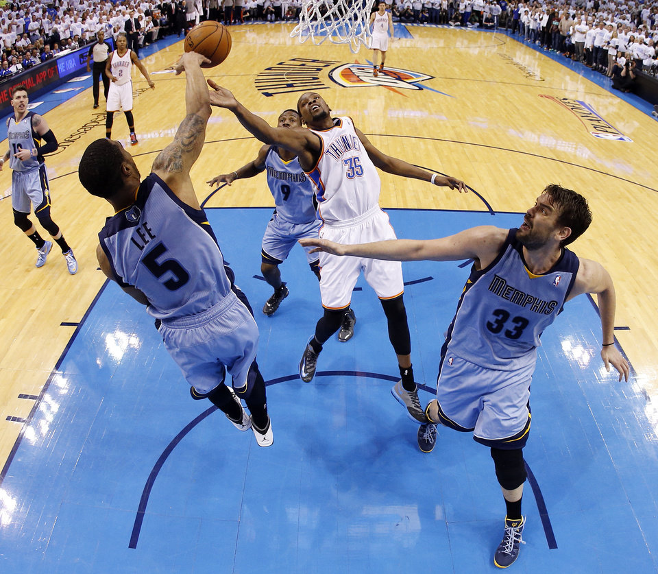 Photo - Oklahoma City's Kevin Durant (35) tries to score against Memphis' Courtney Lee (5), Marc Gasol (33) and Tony Allen (9) during Game 5 in the first round of the NBA playoffs between the Oklahoma City Thunder and the Memphis Grizzlies at Chesapeake Energy Arena in Oklahoma City, Tuesday, April 29, 2014. Photo by Nate Billings, The Oklahoman