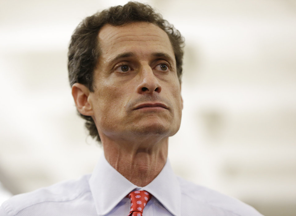 Photo - New York City Mayoral candidate Anthony Weiner takes reporters questions during a news conference at the Gay Men's Health Crisis headquarters, Tuesday, July 23, 2013, in New York. The former congressman says he's not dropping out of the New York City mayoral race in light of newly revealed explicit online correspondence with a young woman. (AP Photo/Kathy Willens)