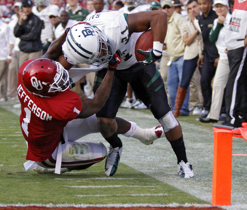 Photo - Oklahoma's Tony Jefferson (1) stops Baylor's Jarred Salubi (21) from getting a two point conversion during the college football game between the University of Oklahoma Sooners (OU) and Baylor University Bears (BU) at Gaylord Family - Oklahoma Memorial Stadium on Saturday, Nov. 10, 2012, in Norman, Okla.  Photo by Chris Landsberger, The Oklahoman