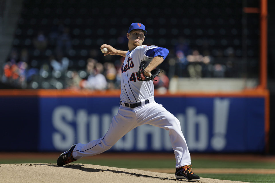 Photo - New York Mets starting pitcher Zack Wheeler throws during the first inning of the baseball game against the Washington Nationals at Citi Field, Thursday, April 3, 2014 in New York. (AP Photo/Seth Wenig)