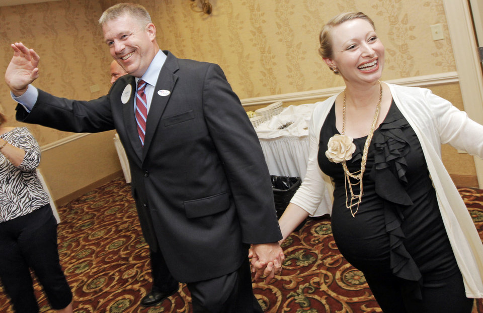 Photo - Kevin Calvey waves to supporters with his wife, Toni Calvey, at the primary watch party for Kevin Calvey, a Republican candidate for Oklahoma's 5th Congressional District seat, at the Stone Garden Hotel and Conference Center in Oklahoma City, Tuesday, July 27, 2010. Photo by Nate Billings, The Oklahoman