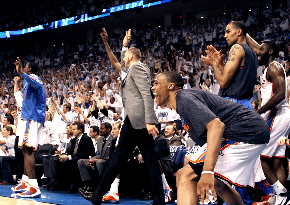 Photo - Oklahoma City's Russell Westbrook (0) celebrates during game five of the Western Conference semifinals between the Memphis Grizzlies and the Oklahoma City Thunder in the NBA basketball playoffs at Oklahoma City Arena in Oklahoma City, Wednesday, May 11, 2011. Photo by Sarah Phipps, The Oklahoman