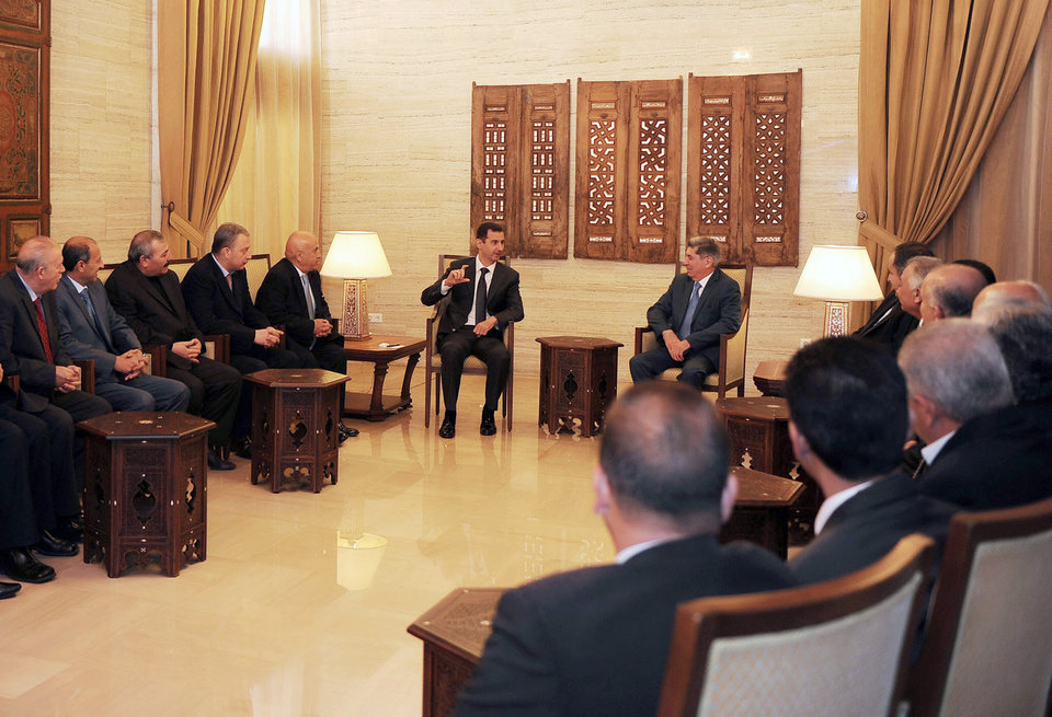 Photo - In this photo released by the Syrian official news agency SANA, Syrian President Bashar Assad, center left, meets with a delegation of Jordanian political activists, lawyers, doctors and engineers in support of him, in Damascus, Syria, Monday, Feb. 11, 2013.  Syrian rebels captured the country's largest dam on Monday after days of intense clashes, giving them control over water and electricity supplies for much of the country in a major blow to President Bashar Assad's regime. (AP Photo/SANA)