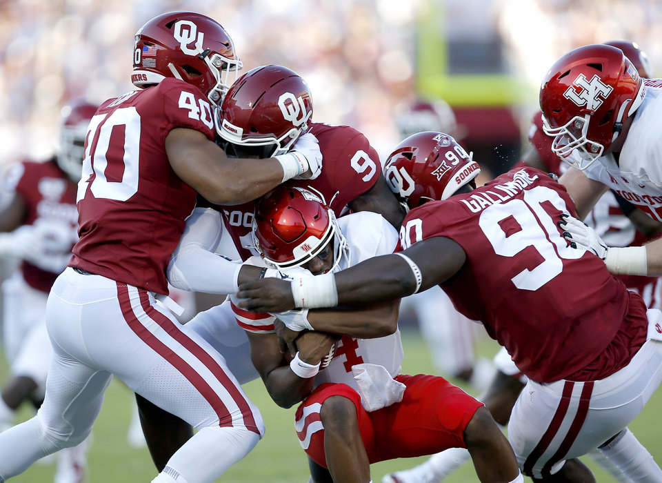 Photo - Oklahoma's Jon-Michael Terry (40), Kenneth Murray (9) and Neville Gallimore (90) sack Houston's D'Eriq King (4) in the first quarter during a college football game between the University of Oklahoma Sooners (OU) and the Houston Cougars at Gaylord Family-Oklahoma Memorial Stadium in Norman, Okla., Sunday, Sept. 1, 2019. [Sarah Phipps/The Oklahoman]