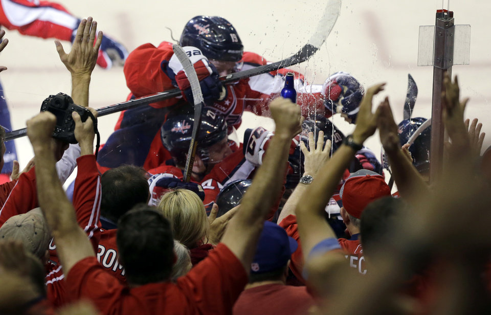 The Washington Capitals and fans celebrate the game-winning goal by center Mike Ribeiro in overtime of Game 5 first-round NHL Stanley Cup playoff hockey series against the New York Rangers, Friday, May 10, 2013, in Washington. The Capitals won 2-1, in overtime. (AP Photo/Alex Brandon)