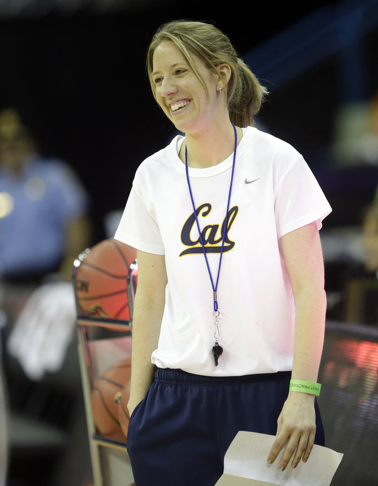 Photo - California head coach Lindsay Gottlieb smiles during practice at the Women's Final Four of the NCAA college basketball tournament, Saturday, April 6, 2013, in New Orleans. California plays Louisville in a national semifinal on Sunday.(AP Photo/Gerald Herbert)