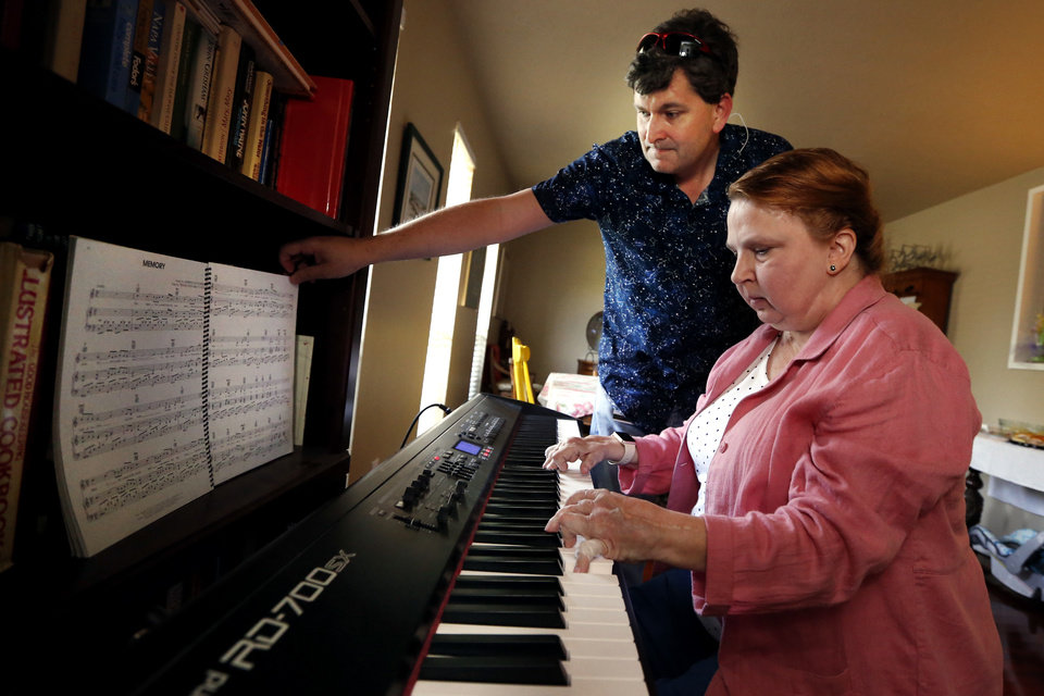 Photo -  Jennene Stanley plays piano and only needs a little help turning pages from husband Brad Stanley. Jennene Stanley has rheumatoid arthritis and other medical conditions that she would like to use marijuana to treat. [Photo by Steve Sisney, The Oklahoman]