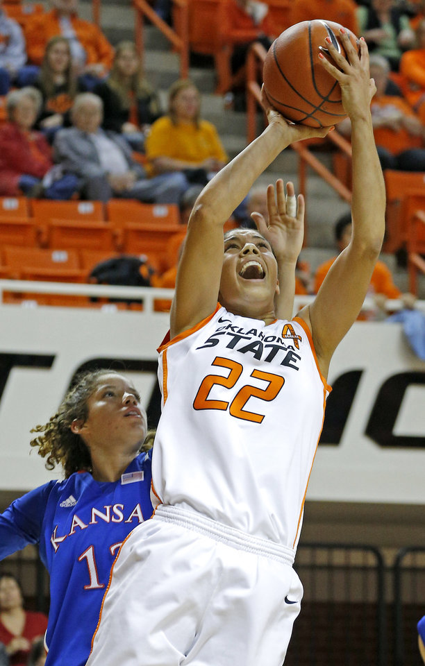 Photo - Oklahoma State's Brittney Martin (22) shoots a basket in front of Kansas' Monica Engelman (13) during a women's college basketball game between Oklahoma State University (OSU) and Kansas at Gallagher-Iba Arena in Stillwater, Okla., Tuesday, Jan. 8, 2013. Oklahoma State won 76-59. Photo by Bryan Terry, The Oklahoman
