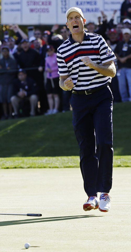 Photo - USA's Jim Furyk reacts after missing a putt on the 16th hole during a singles match at the Ryder Cup PGA golf tournament Sunday, Sept. 30, 2012, at the Medinah Country Club in Medinah, Ill. (AP Photo/David J. Phillip)  ORG XMIT: PGA176