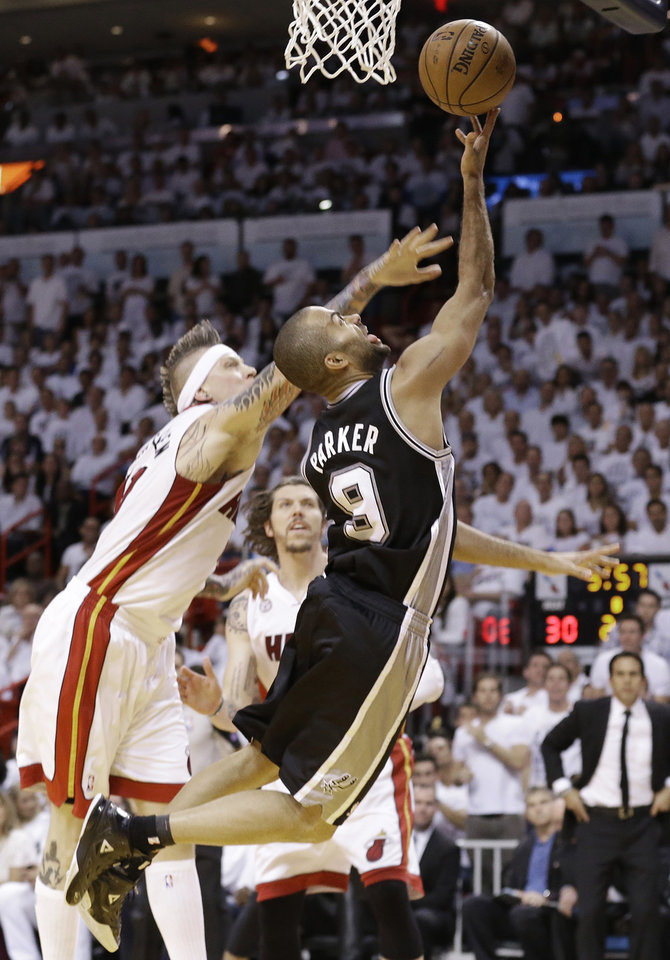Miami Heat's Chris Andersen (11) defends against San Antonio Spurs' Tony Parker (9) during the first half in Game 7 of the NBA basketball championships, Thursday, June 20, 2013, in Miami. (AP Photo/Lynne Sladky)
