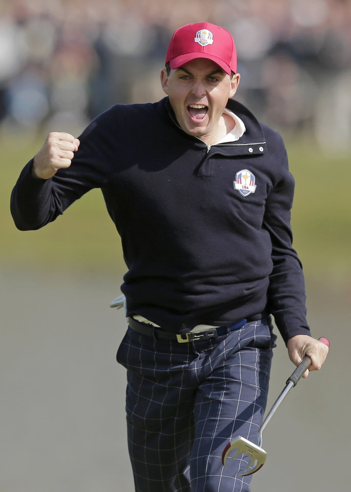 Photo - FILE - In this Sept. 28, 2012, file photo, USA's Keegan Bradley celebrates after winning their foursomes match on the 15th hole at the Ryder Cup PGA golf tournament at the Medinah Country Club in Medinah, Ill. Ryder Cup captain Tom Watson announces his wild-card selections for the American team, Tuesday, Sept. 2, 2014, with Keegan Bradley, Hunter Mahan, Webb Simpson and Chris Kirk among the favorites. (AP Photo/Charlie Riedel, File)