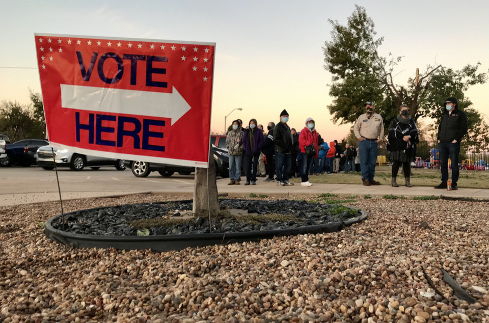 Photo - Voters patiently wait for polls to open Nov. 3, 2020, at Church of the Good Shepherd in Yukon, Okla. Photo by Chris Landsberger