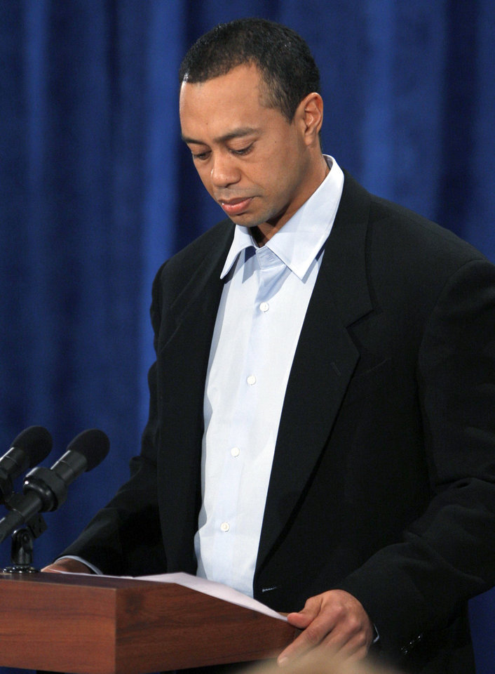 Photo - Tiger Woods makes a statement at the Sawgrass Players Club, Friday, Feb. 19, 2010, in Ponte Vedra Beach, Fla. (AP Photo/Joe Skipper, Pool) ORG XMIT: TWP112