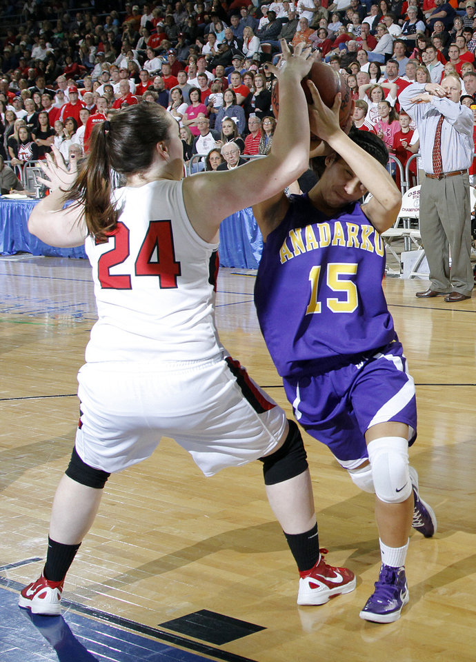 Photo - Ft. Gibson's Brooke Palmer (24) defends on Anadarko's Whitlee Miller (15) during the 4A girls State Basketball Championship game between Ft. Gibson High School and Anadarko High School at State Fair Arena on Saturday, March 10, 2012 in Oklahoma City, Okla.  Photo by Chris Landsberger, The Oklahoman