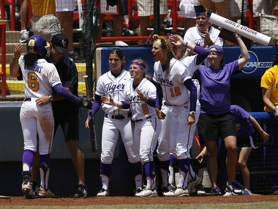 Photo - LSU's A.J. Andrews (6) celebrates with her teammates during a Women's College World Series game between Louisiana State University and the University of South Florida at ASA Hall of Fame Stadium in Oklahoma City, Saturday, June 2, 2012. Photo by Garett Fisbeck, The Oklahoman