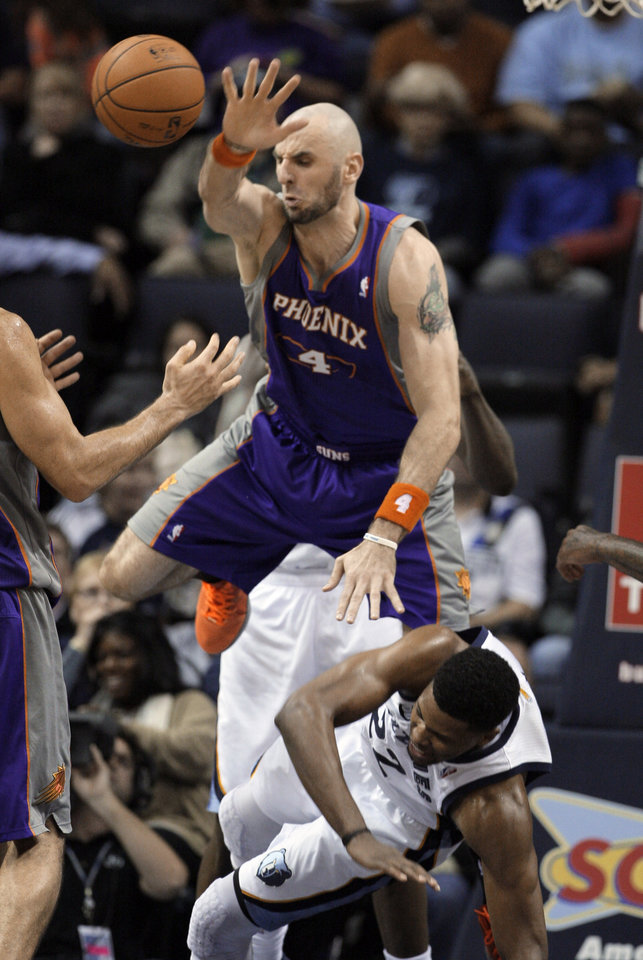 Phoenix Suns' Marcin Gortat (4), of Poland,  ouls Memphis Grizzlies' Rudy Gay during the first half of an NBA basketball game in Memphis, Tenn., Tuesday, Dec. 4, 2012. (AP Photo/Danny Johnston)