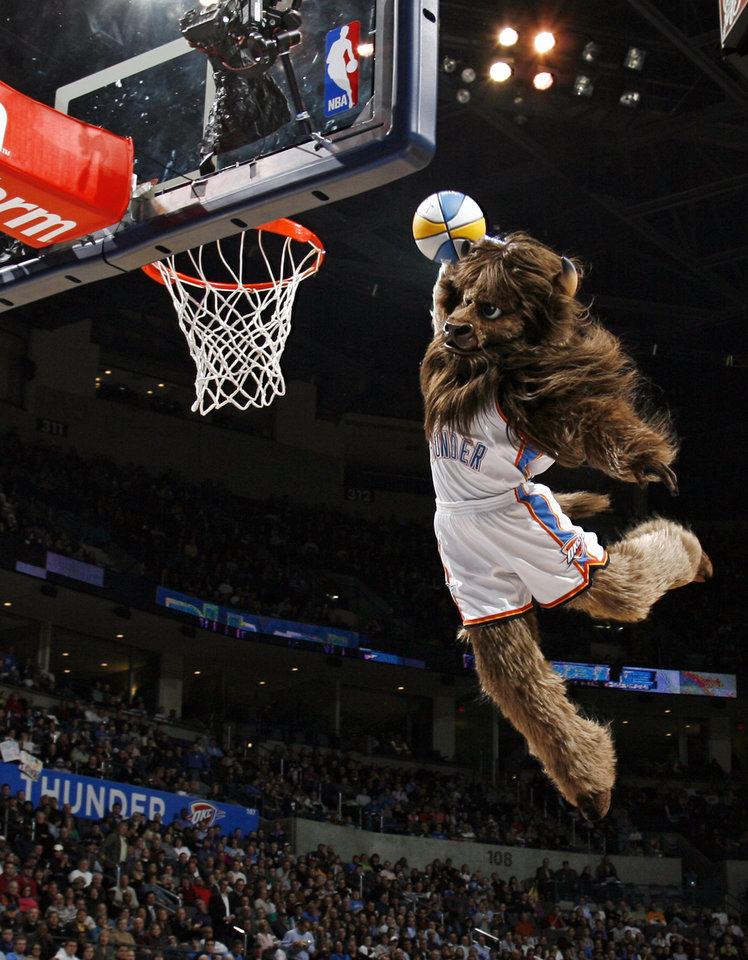 Oklahoma City mascot Rumble the Bison dunks the ball during a timeout in the first half during the NBA basketball game between the Dallas Mavericks and the Oklahoma City Thunder at the Ford Center in Oklahoma City, March 2, 2009. BY NATE BILLINGS, THE OKLAHOMAN