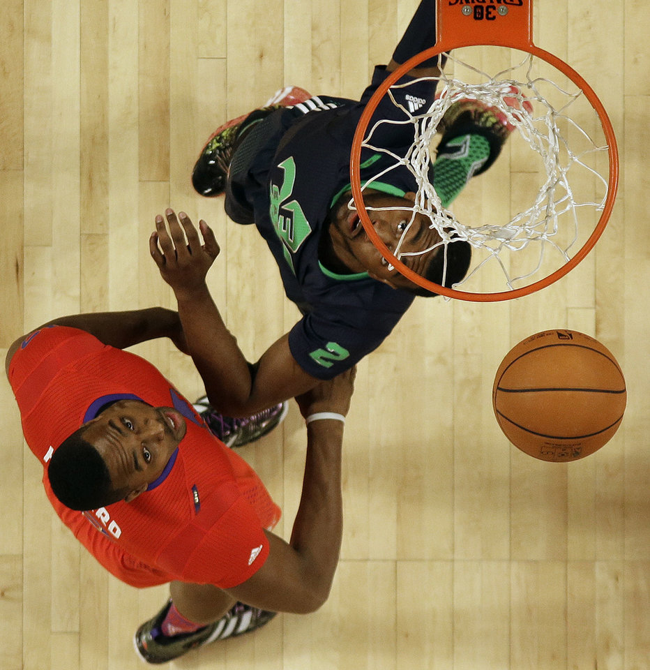 Photo - West Team Dwight Howard, of the Houston Rockets (12) and East Team John Wall, of the Washington Wizards (2) vie for a loose ball during the NBA All Star basketball game, Sunday, Feb. 16, 2014, in New Orleans. (AP Photo/Gerald Herbert)
